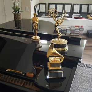 A picture is worth a thousand words. Henry Mancini's piano and a few of his achievements